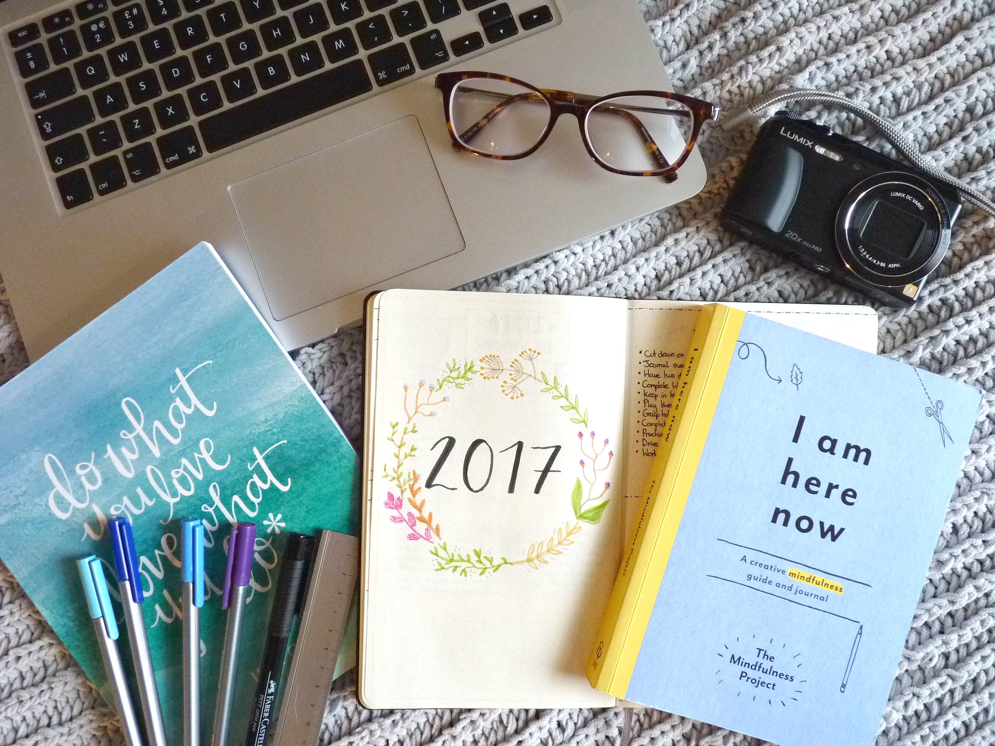 flatlay of laptop bullet journal and stationary, fulfil your potential