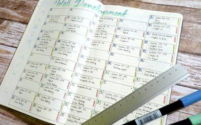 bullet journal with study calendar for web development