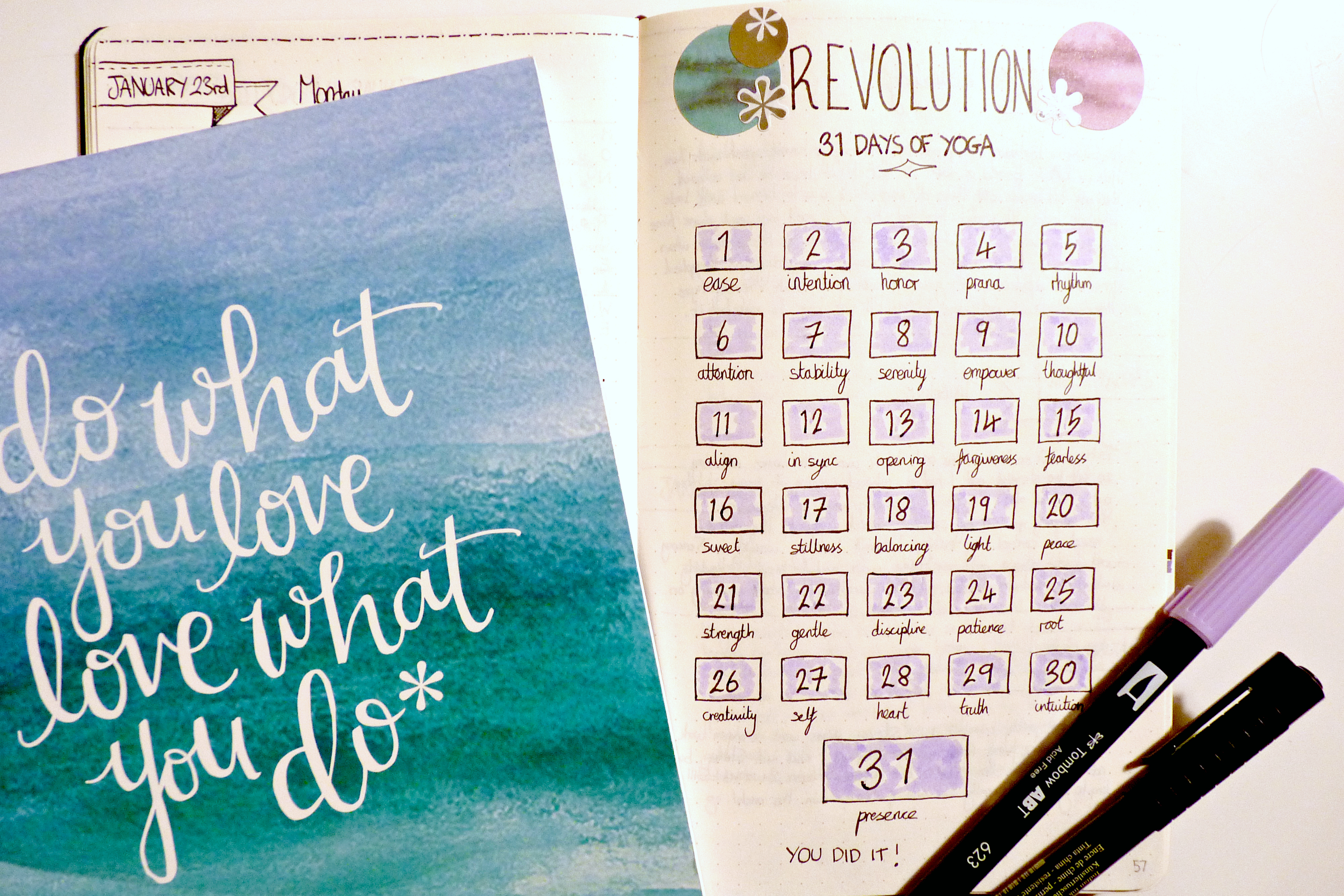 A bullet journal spread of a yoga with Adriene challenge tracker plus tombow brush pens
